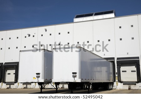 Loading docks under blue sky. - stock photo