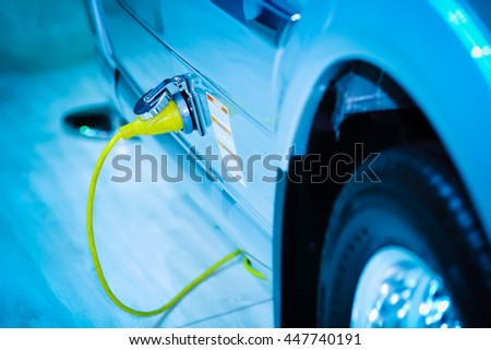Loading energy of an electric car - stock photo