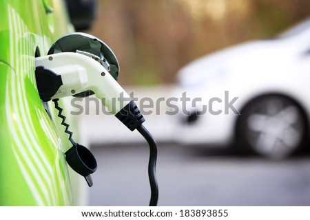 Loading energy of an electric car  in Prague Czech republic - stock photo