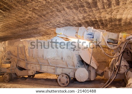 Loading machine attached to heading machine - stock photo