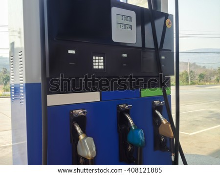 Loading meter gas station with fuel nozzle