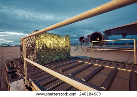 Loading of cargo to the freight aircraft. - stock photo