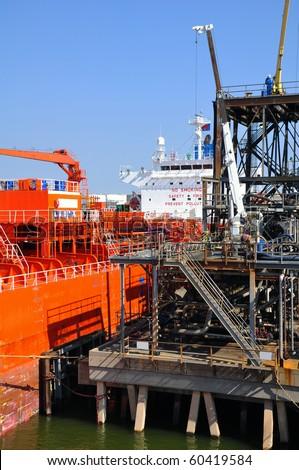 loading of chemical tanker in port - stock photo