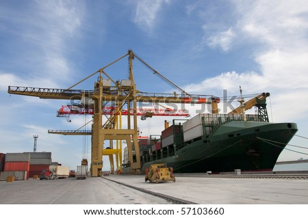 loading of containers on the ship - stock photo
