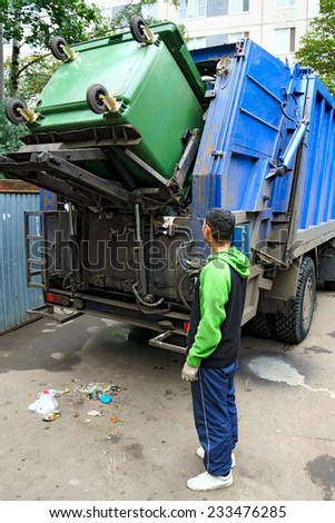 Loading of the garbage container, real photo. - stock photo