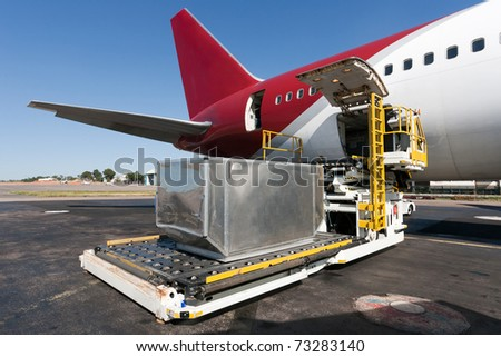 Loading platform of air freight to the aircraft - stock photo