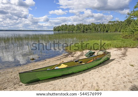 Loading the Canoe on the Shore of Basswood Lake in Quetico Provincila Park in Ontario