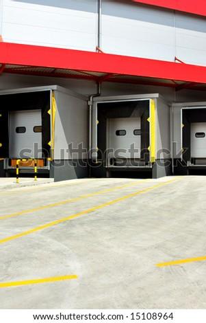 Loading warehouse deck with big cargo doors - stock photo