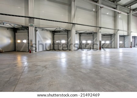 Loading warehouse deck with big cargo doors - stock photo