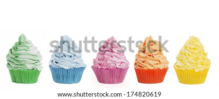 Loads of cupcakes in a row isolated on a white background