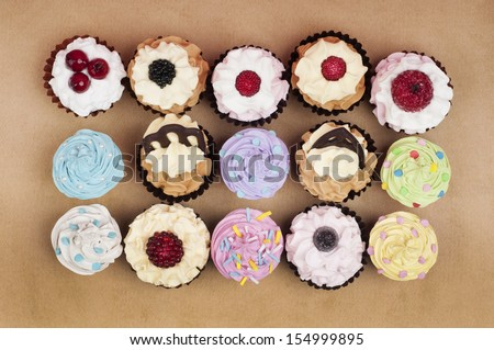 loads of decorated cupcakes from above