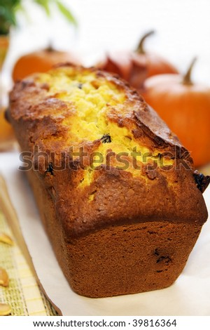 Loaf of autumn pumpkin bread on a wooden board - stock photo