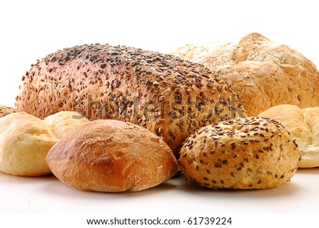 Loaf of bread and rolls isolated on white - stock photo