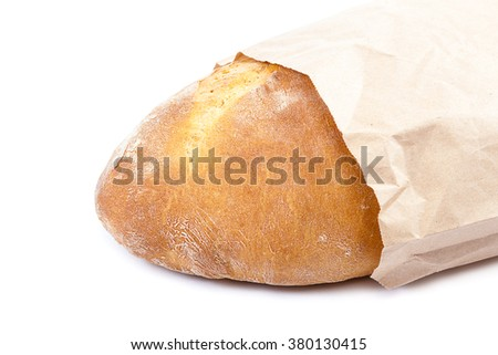 Loaf of bread in a eco-friendly paper bag isolated on white background. - stock photo