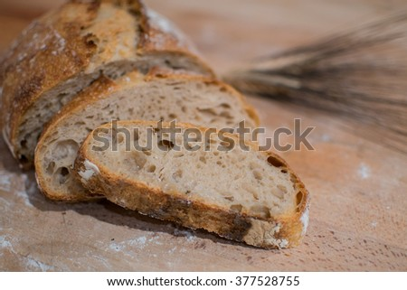loaf of bread made with freshly baked sourdough - stock photo