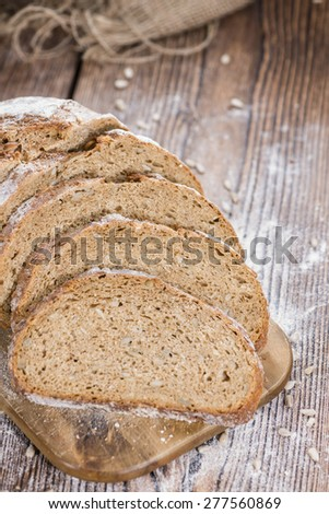 Loaf of Bread on an old dark wooden table - stock photo
