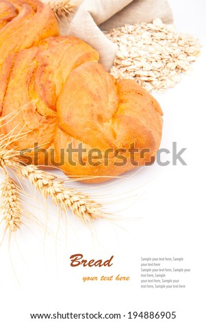 Loaf of bread with oat flakes, spikelets of wheat on white, food photo