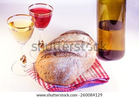 Loaf of bread with wine - stock photo