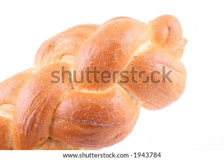 loaf of challah bread isolated on white - stock photo