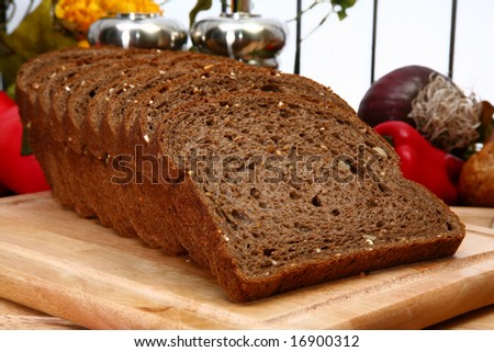 Loaf of dark wheat bread in kitchen. - stock photo