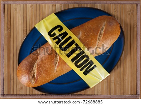 Loaf of French Bread draped in Caution Tape