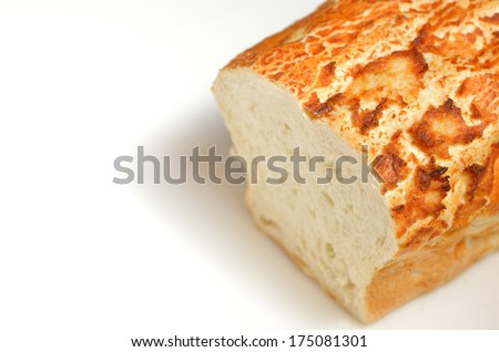 loaf of freshly baked bread with an end sliced off on white background - stock photo