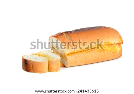 loaf of garlic bread with butter isolated on white - stock photo