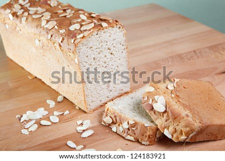 Loaf of gluten-free almond bread indoors on a wooden table - stock photo