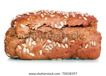 Loaf of rye bread soft tasty poured by sunflower seeds of a sunflower and a round loaf on a background isolated on a white background - stock photo