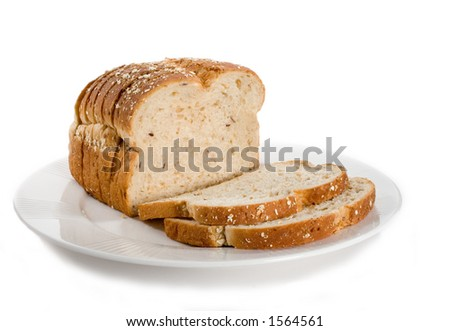 Loaf of sliced bread on plate.  Isolated on white. - stock photo