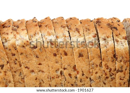 Loaf of sliced brown bread, isolated on white, macro over white