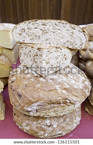 Loaf with flour and seeds, bakery in feed market - stock photo