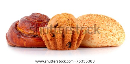 Loaf with raisins and muffin isolated on white