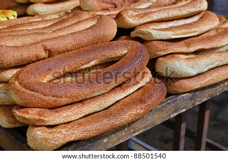 loafs of bagels on market stand - stock photo