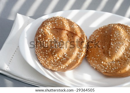 loafs, plate and napkin - stock photo