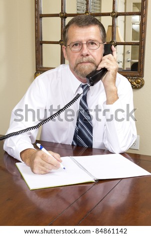 Loan officer at local bank is going to interview over the phone with business man to better understand his needs - stock photo