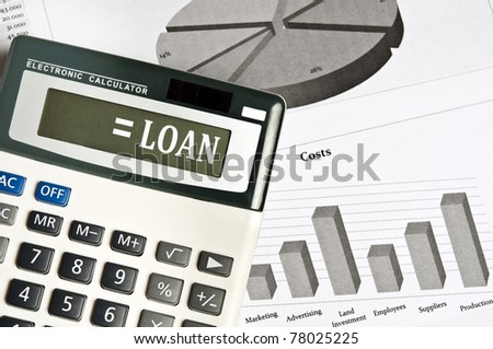 Loan word on electronic calculator - stock photo