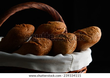 loaves of bread on black background