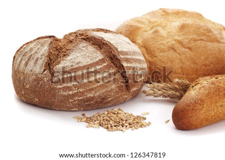 loaves of bread over white background