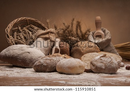 Loaves of bread, rolls and vegetables
