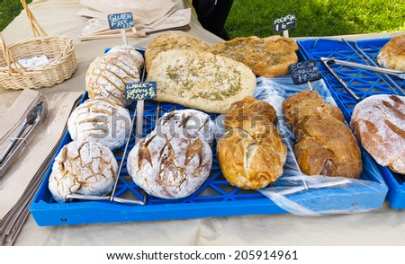 Loaves of Organic Bread for sale at outdoor farmers market - stock photo
