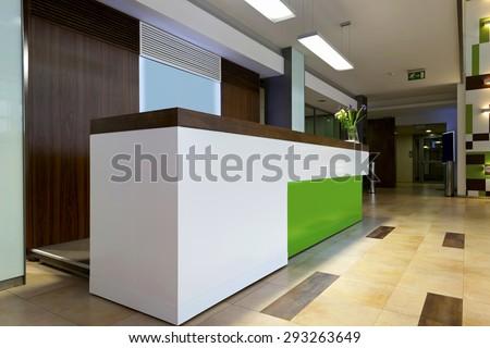 Lobby entrance with reception desk - stock photo