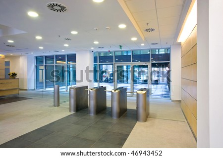 Lobby entrance with turnstile in a business center building - stock photo