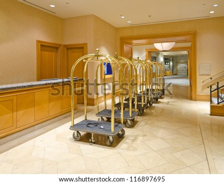 Lobby for the luxury five stars hotel with the luggage carts and the counter. - stock photo