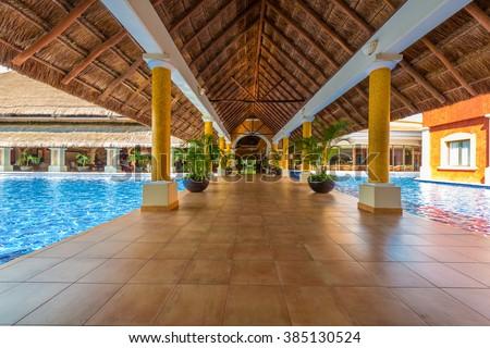 Lobby gallery promenade luxury caribbean tropical stock for Tropical hotel decor