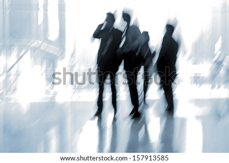 lobby in the rush hour is made in the manner of blur and a blue tonality - stock photo