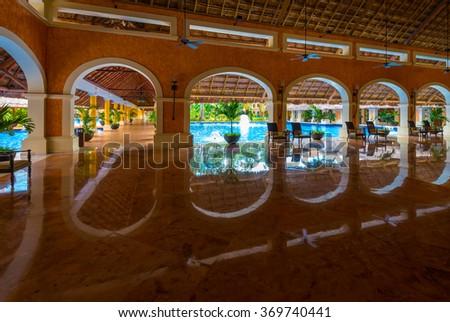 Lobby of the five stars luxury caribbean, tropical hotel, resort. Reception area. Interior design. - stock photo