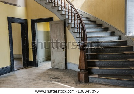 Lobby of the Hotel Meade with a beautiful staircase now used by park visitors and ghosts at Bannack State Park in Montana. - stock photo