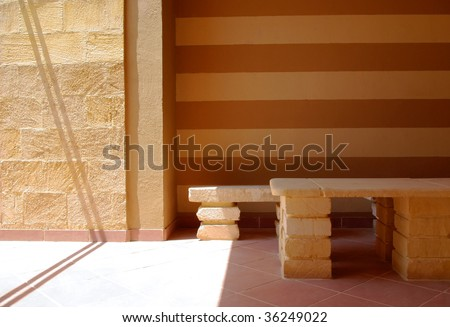 lobby sandstone bench in sunlight and shadow