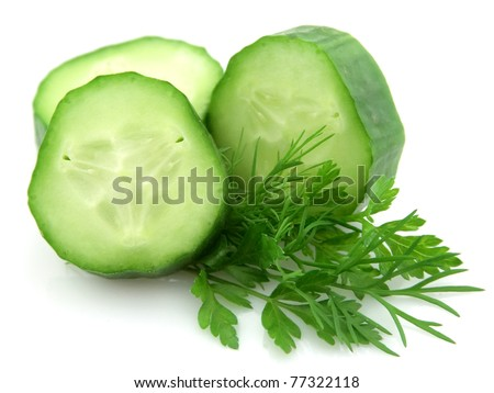 Lobes of a cucumber with parsley and to fennel on a white background - stock photo